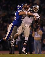 Kansas State quarterback Josh Freeman (1) is hit by Kansas defensive end Jeff Wheeler (84) causing a fumble late in the fourth quarter at Memorial Stadium in Lawrence, Kansas, November 18, 2006.  Kansas beat K-State 39-20.<br />