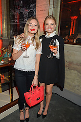 Left to right, sisters AMY NEWMAN and CHARLIE NEWMAN at the Tatler Magazine's Kings & Queens party held at Savini at Criterion, Piccadilly, London on 1st June 2016.