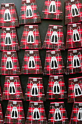 Geometric view of fridge magnets in shape of Scottish kilts for sale in tourist gift shop on the Royal Mile in Edinburgh, Scotland, United Kingdom