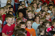 Westfall, Pennsylvania - Delaware Valley  Elementary School students sing a patriotic song during an assembly in the gymnasium where veterans were honored on Nov. 8, 2013.