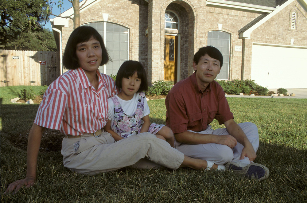 Chinese-American family in front of home in Austin,TX ©Bob Daemmrich<br /> ©Bob Daemmrich