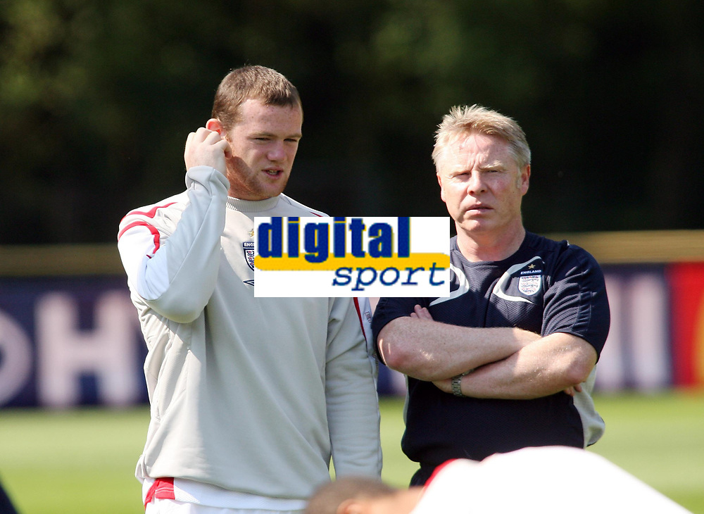 Photo: Chris Ratcliffe.<br />England Training Session. FIFA World Cup 2006. 13/06/2006.<br />Wayne Rooney chats with Sammy Lee during training.