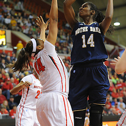 Notre Dame Fighting Irish forward Devereaux Peters (14) shoots over Rutgers Scarlet Knights guard/forward Betnijah Laney (44) during first half NCAA Big East women's basketball action between Notre Dame and Rutgers at the Louis Brown Athletic Center. Notre Dame leads 40-23 at halftime.