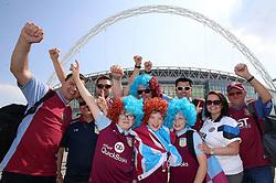 Aston Villa fans pose outside Wembley Way during the Sky Bet Championship Final at Wembley Stadium, London.