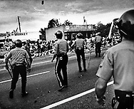 Miami-Dade Police confront a rock hurling crowd as President Jimmy Carter meets with community leaders in Lliberty City soon after the 1980 McDuffie riots in Liberty City, Miami.