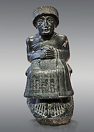 Black diorite statue of Guidea who ruled Lagash from around 2150 BC. The statue called the is dedicated to the god Ningishzida. From the ancient Sumarian city of Lagash. Louvre Museum Paris .<br /> <br /> If you prefer to buy from our ALAMY PHOTO LIBRARY  Collection visit : https://www.alamy.com/portfolio/paul-williams-funkystock  Type -    Lagesh  - into the LOWER SEARCH WITHIN GALLERY box to refine search by adding background colour, place, museum etc<br /> <br /> Visit our ANCIENT WORLD PHOTO COLLECTIONS for more photos to download or buy as wall art prints https://funkystock.photoshelter.com/gallery-collection/Ancient-World-Art-Antiquities-Historic-Sites-Pictures-Images-of/C00006u26yqSkDOM
