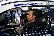 Jimmy Johnson prepares for qualifying for a NASCAR Sprint Cup series auto race, Friday, May 9, 2014, at Kansas Speedway in Kansas City, Kan. (AP Photo/Colin E. Braley)