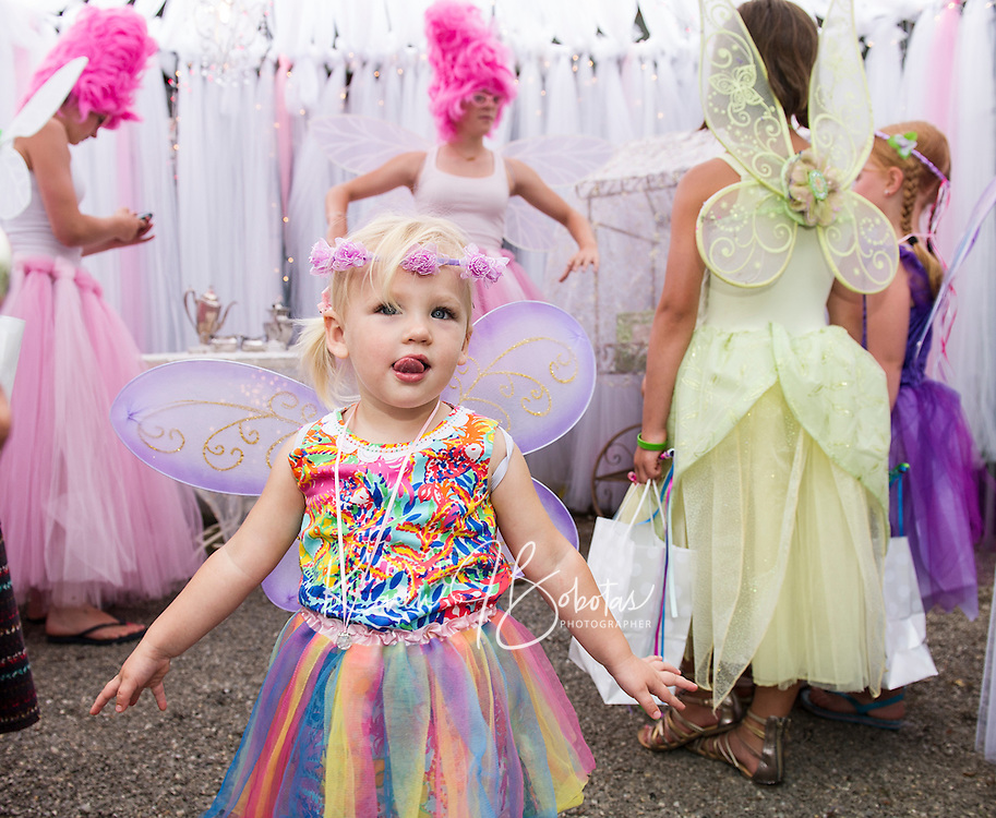 """Olivia Lawton dances to I'm a Little Teapot with """"Glitz"""" and """"Glamour"""" at Cackleberries Fairy Night Wednesday evening.  (Karen Bobotas/for the Laconia Daily Sun)"""