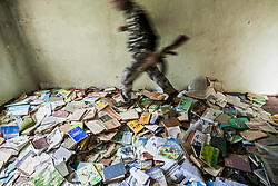 June 2, 2017 - Talish, Martakert, Nagorno Karabakh - A soldier of Nagorno Karabakh army walks over the books on the floor of the library of the Talish school, destroyed by shelling of the Azerbaijan army on 2016. (Credit Image: © Celestino Arce via ZUMA Wire)