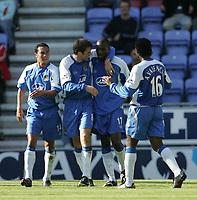 Photo: Andi Thompson.<br />Wigan Athletic v Watford. The Barclays Premiership. 23/09/2006.<br />Wigan celebrate Henri Camara's (2nd, R) goal.