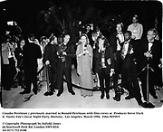 Claudia Perelman ( previously married to Ronald Perelman with film crews  at  Producer Steve Tisch &  Vanity Fair's Oscar Night Party,<br />Mortons,  Los Angeles. March 1994.  Film 94559/5<br /> <br />© Copyright Photograph by Dafydd Jones<br />66 Stockwell Park Rd. London SW9 0DA<br />Tel 0171 733 0108.