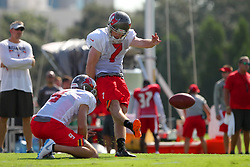 July 28, 2018 - Tampa, FL, U.S. - TAMPA, FL - JULY 28: Chandler Catanzaro (7) kicks from the hold of Bryan Anger (9) during the Tampa Bay Buccaneers Training Camp on July 28, 2018 at One Buccaneer Place in Tampa, Florida. (Photo by Cliff Welch/Icon Sportswire) (Credit Image: © Cliff Welch/Icon SMI via ZUMA Press)