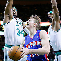 03 April 2013: Detroit Pistons shooting guard Kyle Singler (25) drives past Boston Celtics power forward Chris Wilcox (44) and Boston Celtics small forward Paul Pierce (34) during the Boston Celtics 98-93 victory over the Detroit Pistons at the TD Garden, Boston, Massachusetts, USA.