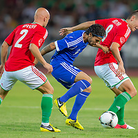 Hungary's Jozsef Varga (L) and Hungary's Adam Pinter (R) fight for the ball with Israel's Lior Refaelov (C) during a riendly football match Hungary playing against Israel in Budapest, Hungary on August 15, 2012. ATTILA VOLGYI