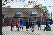Asylum seekers playing Volley ball in the exercise yard inside Napier Barracks on the 3rd of June 2021, Folkestone Kent. Despite today's high court ruling that the Home Office's detention of Asylum seekers in Napier Barracks was unlawful, over 250 asylum seekers are still being kept in unsuitable, accommodation, they are experiencing mental health issues as well as being vulnerable to health conditions including COVID-19.  (photo by Andrew Aitchison / In pictures via Getty Images)