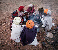 PUSHKAR, INDIA - CIRCA NOVEMBER 2018: Group of camel herders chatting at the Pushkar Camel Fair. It is one of the world's largest camel fairs. Apart from the buying and selling of livestock, it has become an important tourist destination. The city of Pushkar is a pilgrimage site for Hindus and Sikhs.