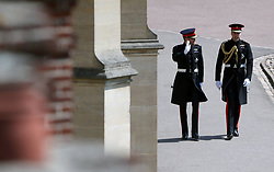 Prince Harry (left) and the Duke of Cambridge arrive for the wedding of Prince Harry and Meghan Markle at Windsor Castle.