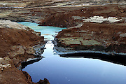 Water pools in sink holes on the shore of the Dead Sea, Israel