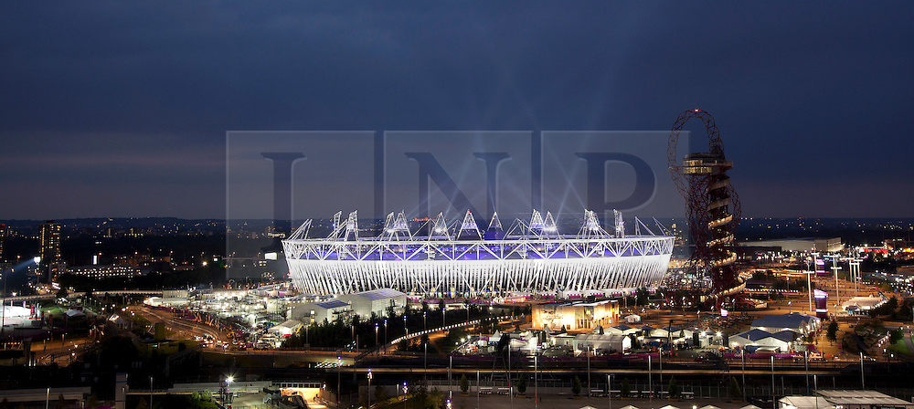 © Licensed to London News Pictures. 27/07/2012. LONDON, UK. The Olympic Stadium is seen during the opening ceremony of the 2012 Summer Olympics in London today (27/07/12). Constituting the third time the Olympic Games have been held in Great Britain, the 2012 Olympic Games, also known as the Games of the XXX Olympiad opened this evening with a show, put together by 'Slum Dog Millionaire' director Danny Boyle, entitled 'The Isles of Wonder. Photo credit: Matt Cetti-Roberts/LNP
