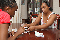 Mother and daughter with money. Cleared for Mental Health issues.