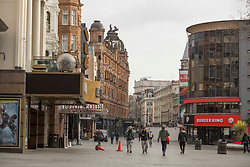 © Licensed to London News Pictures. <br /> London, UK. 24/03/2021. Members of the public are seen walking through Leicester Square, central London one year after the first coronavirus lockdown was announced. <br /> Photo credit: Marcin Nowak/LNP