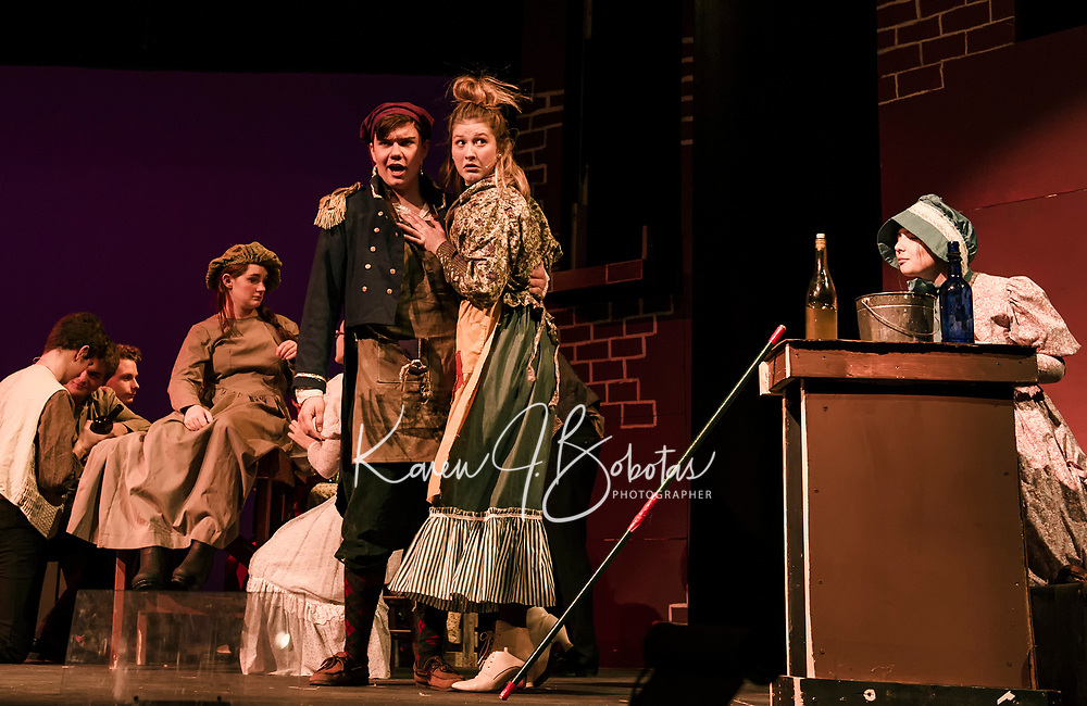 Charles Purcell as Thenardier and Emma Tierno as Madame Thenardier during dress rehearsal for Les Miserables with Gilford High School Thursday evening.  (Karen Bobotas/for the Laconia Daily Sun)