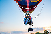 Tandem hot air balloon A man and woman sit on a seat