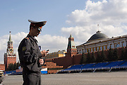 Moscow, Russia, 07/05/2006..A police officer guarding Red Square during parade preparations using a mobile phone.