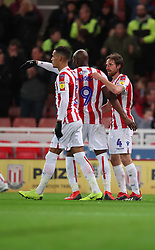 Stoke City's Joe Allen (right) is congratulated by team mate Benik Afobe after scoring his side's second goal during the Sky Bet Championship match at the bet365 Stadium in Stoke.