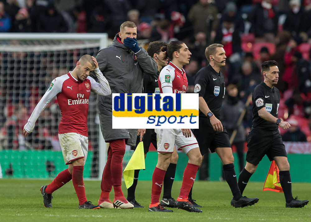 Football - 2018 Carabao (EFL/League) Cup Final - Manchester City vs. Arsenal<br /> <br /> Jack Wilshere (Arsenal FC) is escorted off the pitch by Per Mertesacker (Arsenal FC) to prevent any further confrontation with the referee at Wembley.<br /> <br /> COLORSPORT/DANIEL BEARHAM