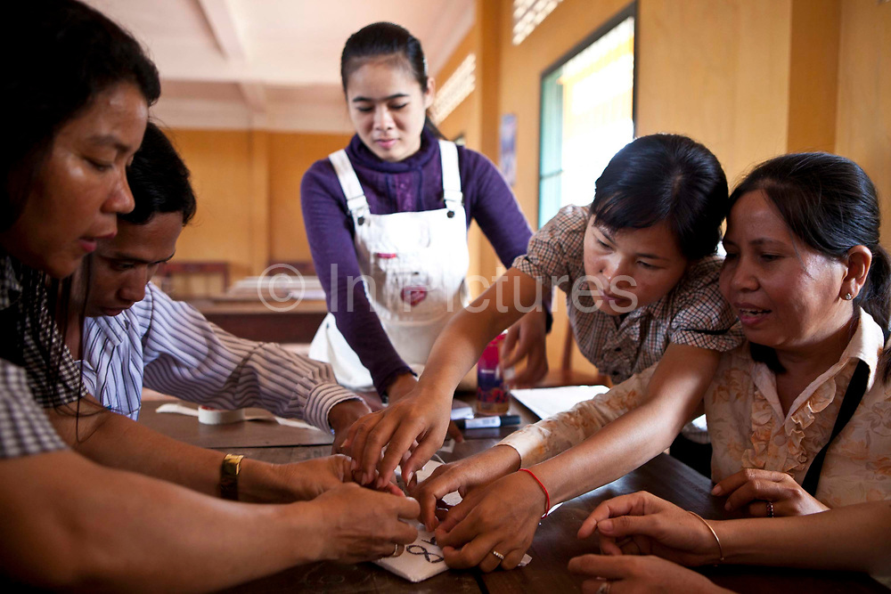 Trainee teachers receiving 6 weeks of training at the Krousar Thmey School for Deaf and Blind Children in Phnom Penh. The Krousar Thmey Foundation assists underprivileged children across Cambodia.
