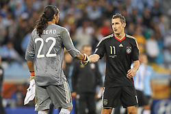 03.07.2010, CAPE TOWN, SOUTH AFRICA,  Goalkeeper Sergio Romero of Argentina shakes hands with Miroslav Klose of Germany after germany beat Argentina 4-0 to reach the semi finals during the Quarter Final Match 59 of the 2010 FIFA World Cup, Argentina vs Germany held at the Cape Town Stadium EXPA Pictures © 2010, PhotoCredit: EXPA/ nph/  Kokenge