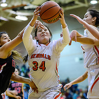 Gallup Bengal Summer Chee (34) grabs a rebound away from Grants Pirate Angelica Nañez (4) Friday at Gallup High School.