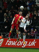 Pictured: Ben Davies of Wales battling for a header against Andreas Weimann of Austria Wednesday 06 February 2013..Re: Vauxhall International Friendly, Wales v Austria at the Liberty Stadium, Swansea, south Wales.