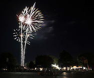 Montgomery, New York -People watch fireworks explode in the sky over a park during a fair on July 17, 2010.