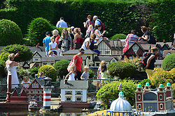 © Licensed to London News Pictures. 29/08/2013. Beaconsfield, UK People enjoy the sunshine and hot weather at Bekonscot Model Village in Berkshire today 29th August 2013. Bekonscot Model Village and Railway is the world's oldest and original model village, opening for the first time in 1929. With over 80 years of history, huge model railway, 1.5 acres of well kept gardens and finely detailed model buildings. Photo credit : Stephen Simpson/LNP