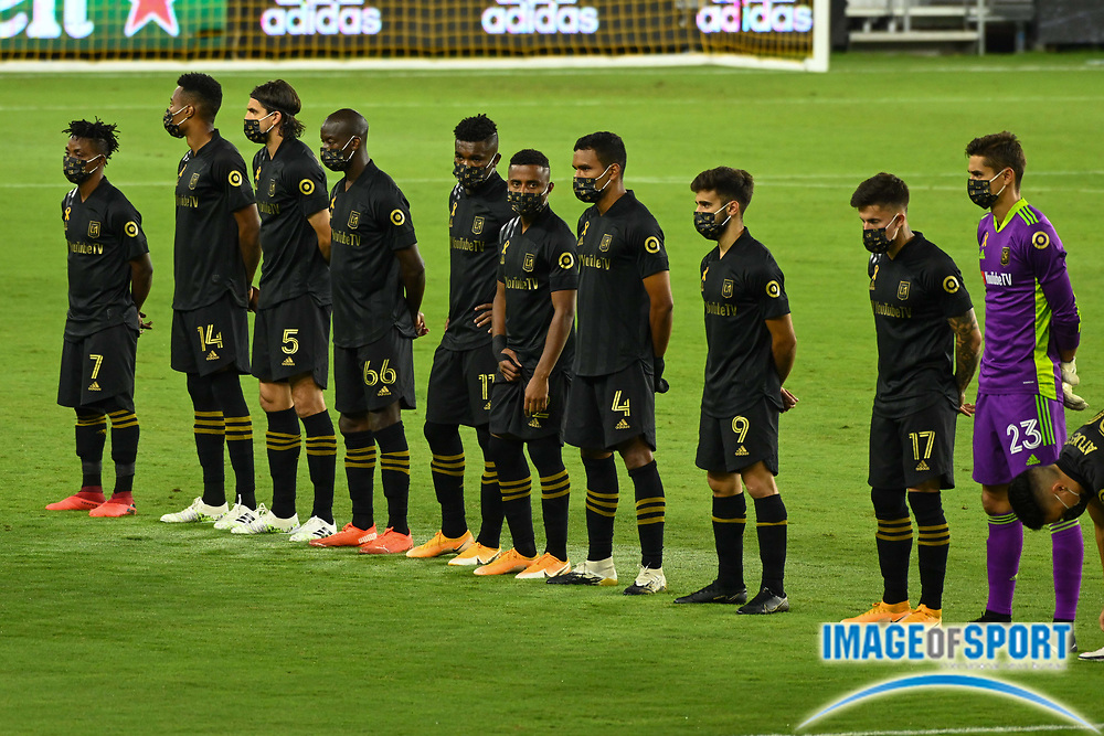 LAFC players stand in a moment of silence in honor of the firefighters lost in recent California wildfires, before a MLS soccer game, Sunday, Sept. 27, 2020, in Los Angeles. The San Jose Earthquakes defeated LAFC 2-1.(Dylan Stewart/Image of Sport)