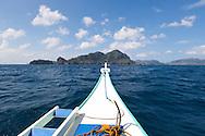 Sailing towards a remote island just off shore from El Nido Towan, Palawan, Philippines.