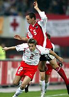 ◊Copyright:<br />GEPA pictures<br />◊Photographer:<br />Mario Kneisl<br />◊Name:<br />Pogatetz<br />◊Rubric:<br />Sport<br />◊Type:<br />Fussball<br />◊Event:<br />OEFB, WM Qualifikation, Laenderspiel, Oesterreich vs Polen, AUT vs POL<br />◊Site:<br />Wien, Austria<br />◊Date:<br />09/10/04<br />◊Description:<br />Emanuel Pogatetz (AUT), Marcin Zajac (POL)<br />◊Archive:<br />DCSKN-091004311<br />◊RegDate:<br />09.10.2004<br />◊Note:<br />8 MB - BK/WU