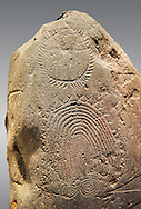 """Detail of prehistoric  petroglyphs, rock carvings, of geometric designs carved by the the prehistoric Camuni people in the Copper Age around the 3rd milleneum BC, Stele """"Bagnolo 2"""" found in 1972 from Malegno near Bangnolo Ceresolo. Museo Nazionale della Preistoria della Valle Camonica ( National Museum of Prehistory in Valle Cominca ), Lombardy, Italy. Grey Background .<br /> <br /> If you prefer you can also buy from our ALAMY PHOTO LIBRARY  Collection visit : https://www.alamy.com/portfolio/paul-williams-funkystock/valcamonica-menhir-museum.html<br /> Visit our PREHISTORIC PLACES PHOTO COLLECTIONS for more  photos to download or buy as prints https://funkystock.photoshelter.com/gallery-collection/Prehistoric-Neolithic-Sites-Art-Artefacts-Pictures-Photos/C0000tfxw63zrUT4"""