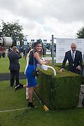 TONYA MELLI; JON ZAMMETT, Ladies Day, Glorious Goodwood. Goodwood. August 2, 2012