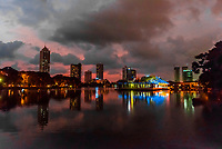 Beira Lake with skyline of Colombo at twilight behind, Sri Lanka.