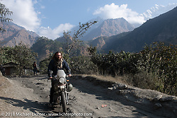 Bear Haughton with the Annapurna Range in the background on Day-7 of our Himalayan Heroes adventure riding from Tatopani to Pokhara, Nepal. Monday, November 12, 2018. Photography ©2018 Michael Lichter.