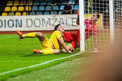 Matej Podlogar of NK Domzale and Johan Dahli of Malmo FF during Football match between NK Domzale and Malmo FF in Second Qualifying match of UEFA Europa League 2019/2020, on July 25th, 2019 in Sports park Domzale, Domzale, Slovenia. Photo by Grega Valancic / Sportida