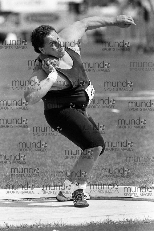 (Montreal, Canada --- 25 July 1991) Peter Dajia in the shot put at the 1991 Canadian National Track and Field Championships held at the Complexe sportif Claude-Robillard in Montreal. Photo 1991 Copyright Sean Burges / Mundo Sport Images. ******This is an unprocessed scan from the negative. You can buy it as is and clean it up yourself, or contact us for rates on providing the service for you. *******