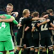 NLD/Amsterdam/20181023 - Champions Leaguewedstrijd  Ajax - SL Benfica, blijdschap bij ajax na de overwinning, nr. 4 Matthijs de Ligt viert het met keeper nr.24 Andre Onana