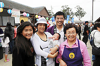 From left, Julianne Eitoku, Grace Eitoku holding young Kai, Jimmy Eitoku, and Chieko Eitoku at Sunday's 63rd annual Obon Festival at the Buddhist Temple of Salinas. They live in the Off 68 corridor.