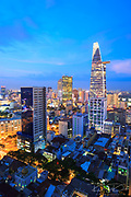 HO CHI MINH CITY, VIETNAM - JUNE 9, 2015 : Verticle view Saigon sunset evening view on high at downtown center with buildings across riverside Saigon river Ho Chi Minh City