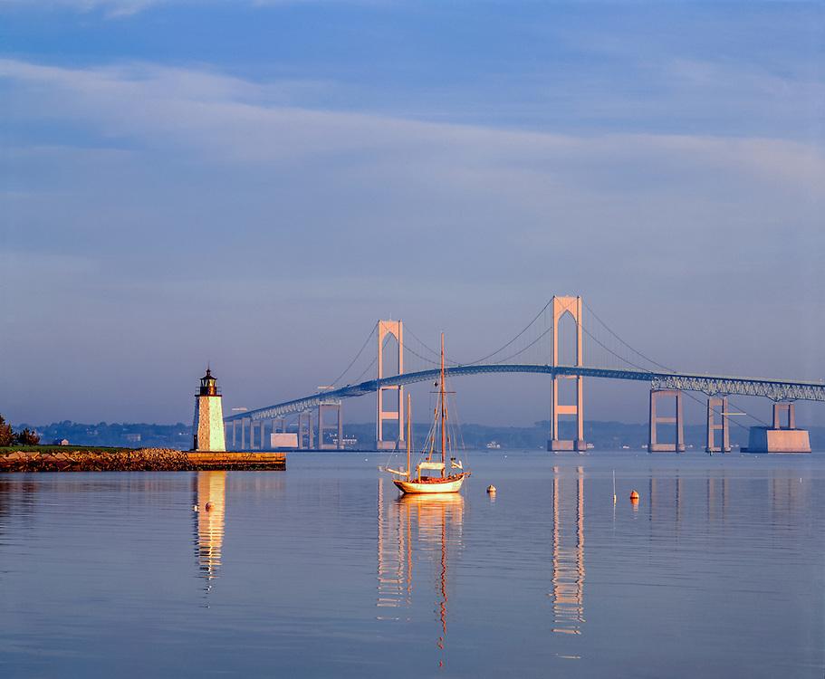 Goat Island lighthouse w/sailboat & Newport Bridge, Newport, RI