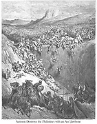 Samson Destroying the Philistines With the Jawbone of an Ass Judges 15:15 From the book 'Bible Gallery' Illustrated by Gustave Dore with Memoir of Dore and Descriptive Letter-press by Talbot W. Chambers D.D. Published by Cassell & Company Limited in London and simultaneously by Mame in Tours, France in 1866